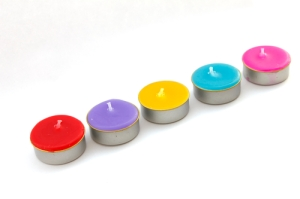 Colorful short candles without flame. Isolated over white background Stock Photo